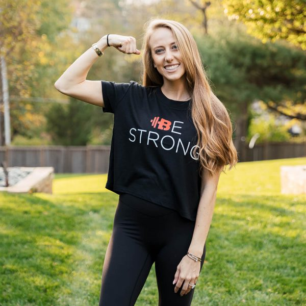 "Brittany Lynne Fitness ""Be Strong"" Cropped T-shirt with Brittany flexing"