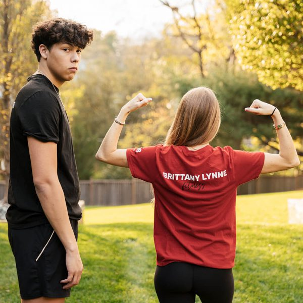 Brittany Lynne Fitness Red T-Shirt with Brittany flexing